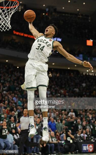 Giannis Antetokounmpo of the Milwaukee Bucks goes up for a dunk against the Boston Celtics at Fiserv Forum on May 08 2019 in Milwaukee Wisconsin The...