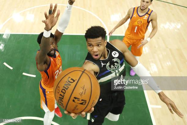 Giannis Antetokounmpo of the Milwaukee Bucks goes up for a shot against Deandre Ayton of the Phoenix Suns during the second half in Game Six of the...