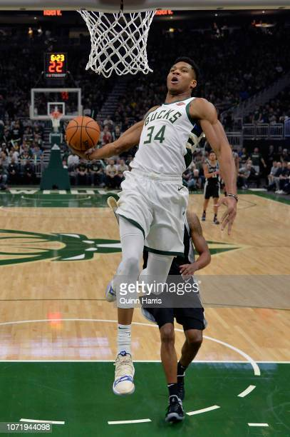 Giannis Antetokounmpo of the Milwaukee Bucks goes up to dunk against LaMarcus Aldridge of the San Antonio Spurs at Fiserv Forum on November 24 2018...