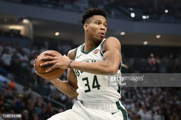 Giannis Antetokounmpo of the Milwaukee Bucks grabs a rebound in the first quarter against the Boston Celtics during Game One of Round Two of the 2019...