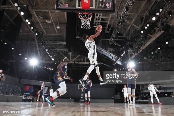 Giannis Antetokounmpo of the Milwaukee Bucks grabs the rebound against the New Orleans Pelicans during a scrimmage on July 27, 2020 at The Arena at...