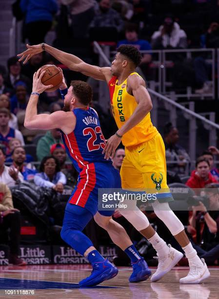 Giannis Antetokounmpo of the Milwaukee Bucks guards Blake Griffin of the Detroit Pistons during the fourth quarter of the game at Little Caesars...