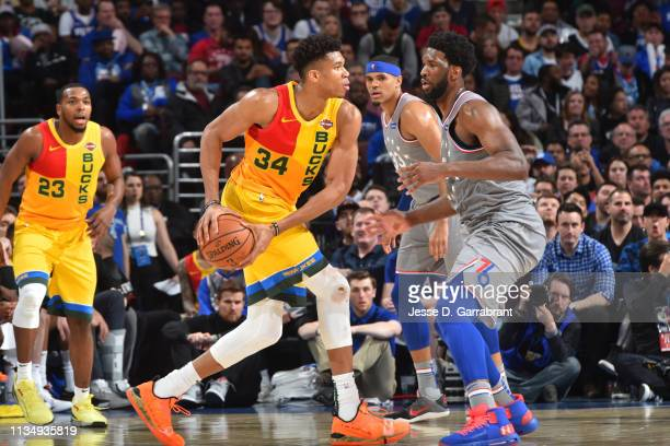Giannis Antetokounmpo of the Milwaukee Bucks handles the ball against Joel Embiid of the Philadelphia 76ers on April 4 2019 at the Wells Fargo Center...