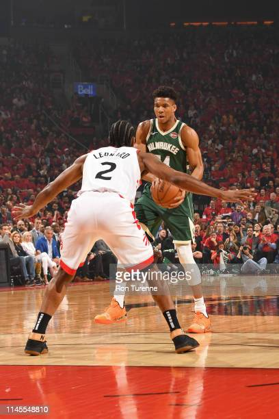 Giannis Antetokounmpo of the Milwaukee Bucks handles the ball against Kawhi Leonard of the Toronto Raptors during Game Four of the Eastern Conference...