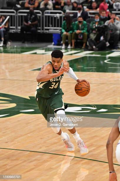 Giannis Antetokounmpo of the Milwaukee Bucks handles the ball against the Phoenix Suns during Game Three of the 2021 NBA Finals on July 11, 2021 at...