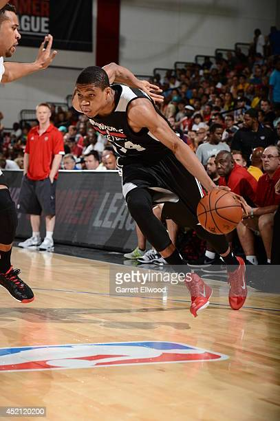 Giannis Antetokounmpo of the Milwaukee Bucks handles the ball against the Phoenix Suns at the Samsung NBA Summer League 2014 on July 13 2014 at the...
