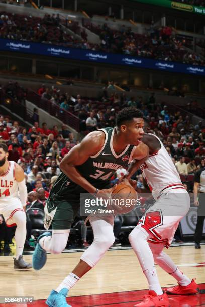 Giannis Antetokounmpo of the Milwaukee Bucks handles the ball against the Chicago Bulls during the preseason game on October 6 2017 at the United...