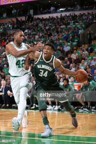 Giannis Antetokounmpo of the Milwaukee Bucks handles the ball against the Boston Celtics on October 18 2017 at the TD Garden in Boston Massachusetts...