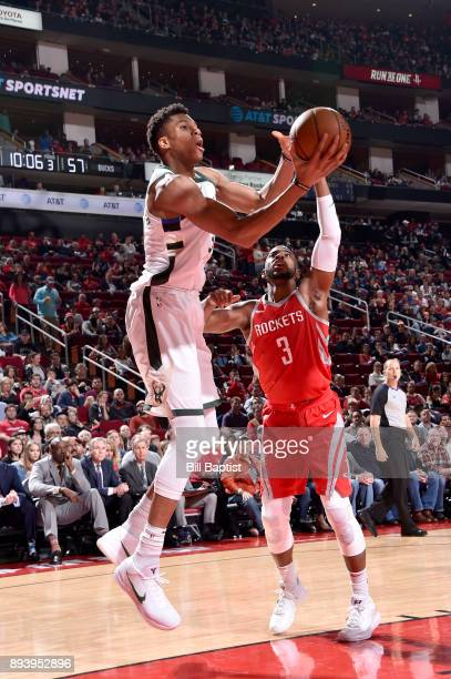 Giannis Antetokounmpo of the Milwaukee Bucks handles the ball against Chris Paul of the Houston Rockets on December 16 2017 at the Toyota Center in...