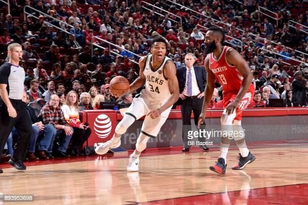 Giannis Antetokounmpo of the Milwaukee Bucks handles the ball against the Houston Rockets on December 16 2017 at the Toyota Center in Houston Texas...