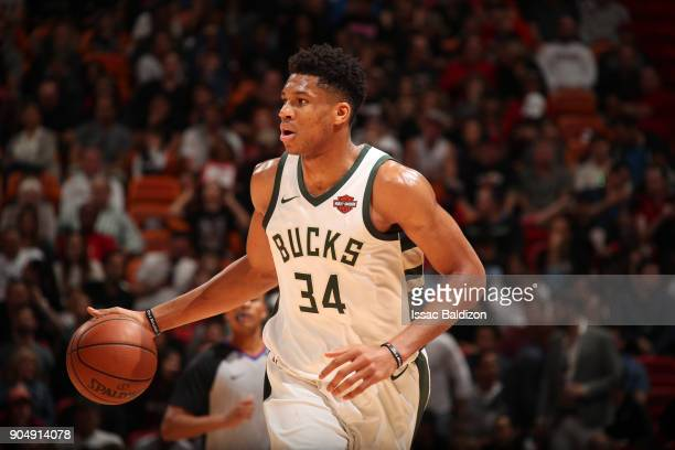 Giannis Antetokounmpo of the Milwaukee Bucks handles the ball against the Miami Heat on January 14 2018 at American Airlines Arena in Miami Florida...