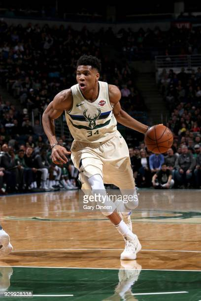 Giannis Antetokounmpo of the Milwaukee Bucks handles the ball against the New York Knicks on March 9 2018 at the BMO Harris Bradley Center in...