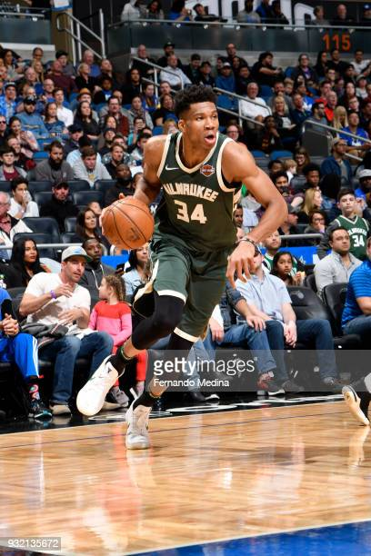 Giannis Antetokounmpo of the Milwaukee Bucks handles the ball against the Orlando Magic on March 14 2018 at Amway Center in Orlando Florida NOTE TO...