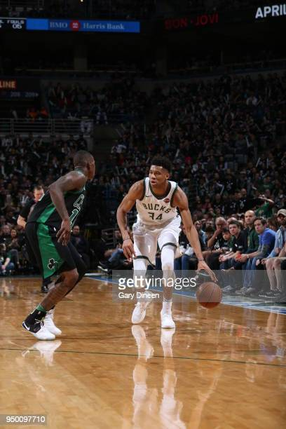 Giannis Antetokounmpo of the Milwaukee Bucks handles the ball against the Boston Celtics in Game Four of Round One of the 2018 NBA Playoffs on April...