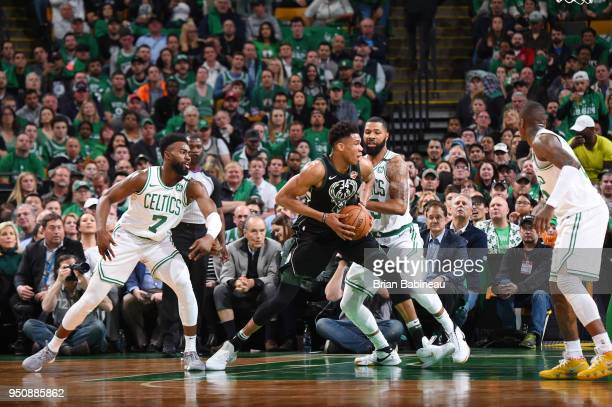 Giannis Antetokounmpo of the Milwaukee Bucks handles the ball against the Boston Celtics during Game Five of Round One of the 2018 NBA Playoffs on...
