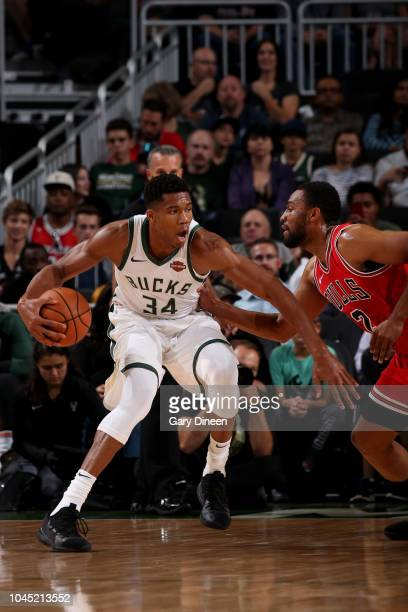 Giannis Antetokounmpo of the Milwaukee Bucks handles the ball during a preseason game on October 3 2018 at Fiserv Forum in Milwaukee Wisconsin NOTE...
