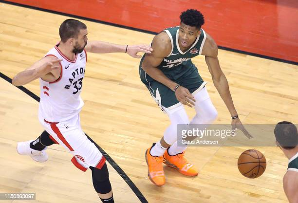 Giannis Antetokounmpo of the Milwaukee Bucks handles the ball during the second half against Marc Gasol of the Toronto Raptors in game four of the...