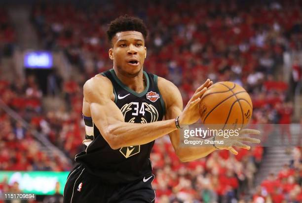Giannis Antetokounmpo of the Milwaukee Bucks handles the ball during the first half against the Toronto Raptors in game six of the NBA Eastern...