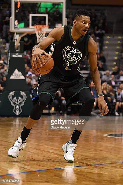 Giannis Antetokounmpo of the Milwaukee Bucks handles the ball during a game against the Toronto Raptors at the BMO Harris Bradley Center on November...