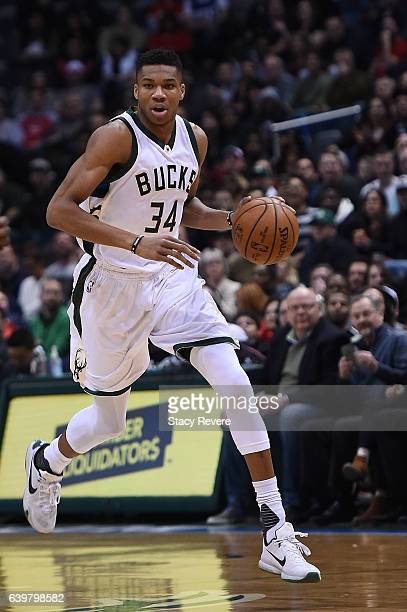 Giannis Antetokounmpo of the Milwaukee Bucks handles the ball during a game against the Houston Rockets at BMO Harris Bradley Center on January 23...