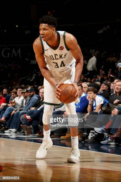 Giannis Antetokounmpo of the Milwaukee Bucks handles the ball during the game against the Washington Wizards on January 15 2018 at Capital One Arena...