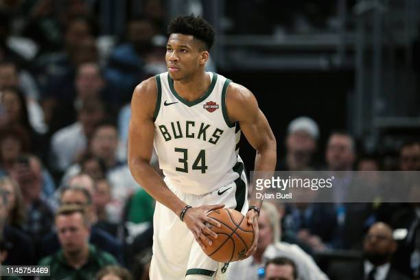 Giannis Antetokounmpo of the Milwaukee Bucks handles the ball in the first quarter against the Boston Celtics during Game One of Round Two of the...