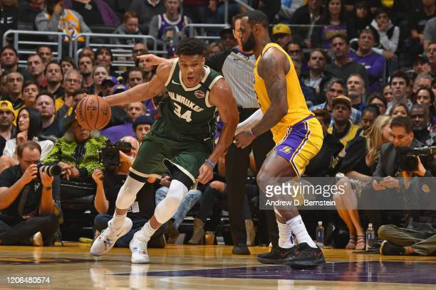 Giannis Antetokounmpo of the Milwaukee Bucks handles the ball while LeBron James of the Los Angeles Lakers plays defense on March 6 2020 at STAPLES...