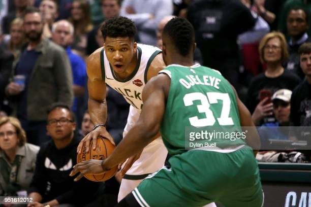 Giannis Antetokounmpo of the Milwaukee Bucks handles the ball while being guarded by Semi Ojeleye of the Boston Celtics in the fourth quarter during...