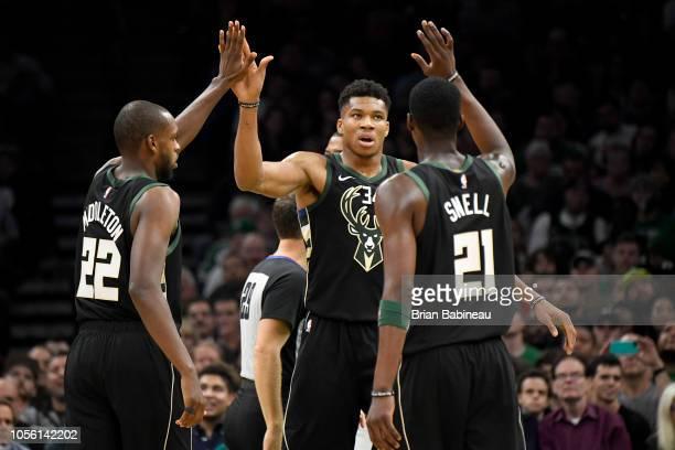 Giannis Antetokounmpo of the Milwaukee Bucks high fives his teammates during the game against the Boston Celtics on November 1 2018 at the TD Garden...