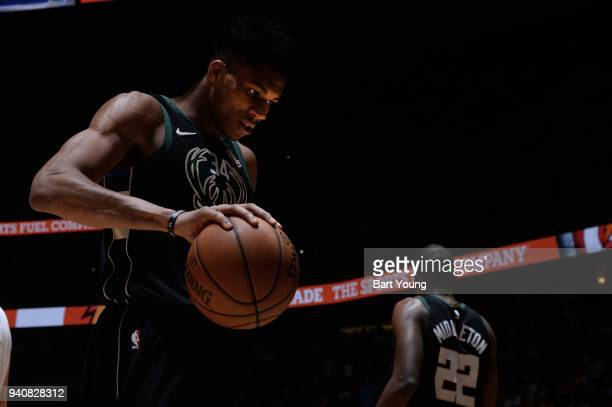 Giannis Antetokounmpo of the Milwaukee Bucks holds the ball during the game against the Denver Nuggets on April 1 2018 at the Pepsi Center in Denver...