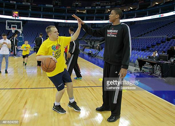 Giannis Antetokounmpo of the Milwaukee Bucks interacts with the kids during the NBA Cares Unified Basketball Clinic as part of the 2015 Global Games...