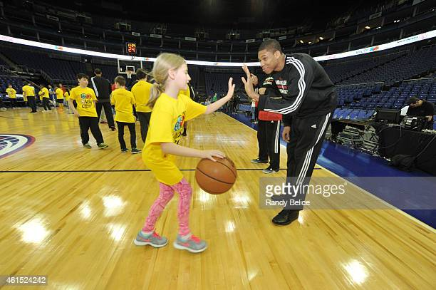 Giannis Antetokounmpo of the Milwaukee Bucks interacts with the participants during the NBA Cares Unified Basketball Clinic as part of the 2015...