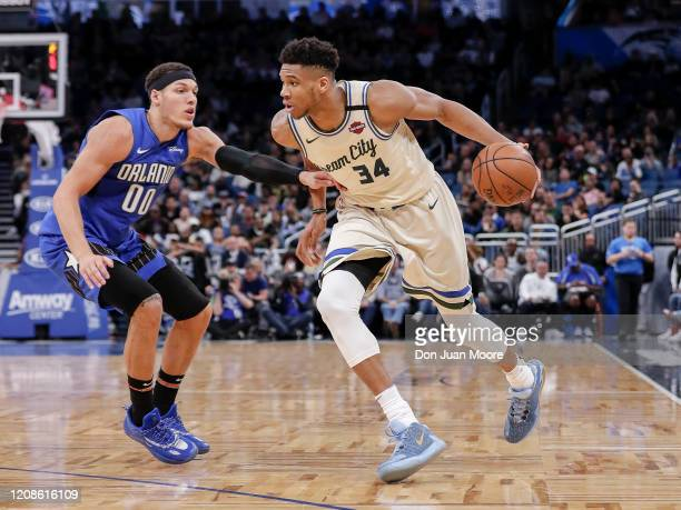 Giannis Antetokounmpo of the Milwaukee Bucks is defended by Aaron Gordon of the Orlando Magic during the game at the Amway Center on February 8 2020...