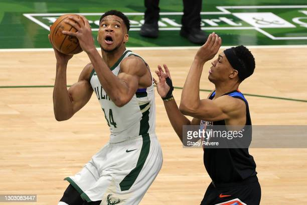 Giannis Antetokounmpo of the Milwaukee Bucks is defended by Darius Bazley of the Oklahoma City Thunder during the second half of a game at Fiserv...