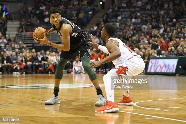 Giannis Antetokounmpo of the Milwaukee Bucks is defended by David Nwaba of the Chicago Bulls during a game at the Bradley Center on December 15 2017...