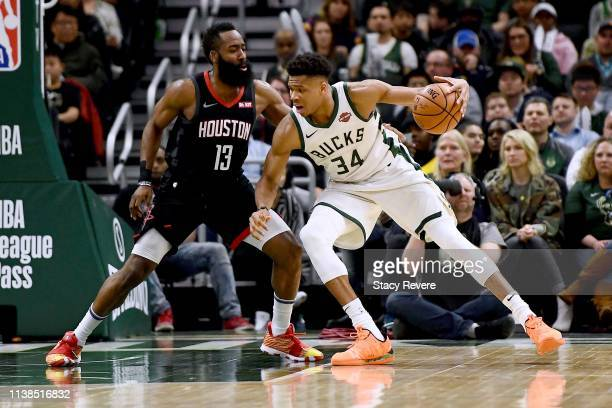 Giannis Antetokounmpo of the Milwaukee Bucks is defended by James Harden of the Houston Rockets during the second half of a game at Fiserv Forum on...