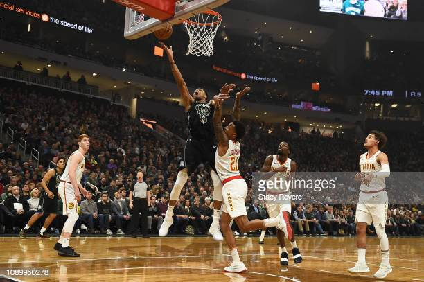 Giannis Antetokounmpo of the Milwaukee Bucks is defended by John Collins of the Atlanta Hawks during the first half of a game at Fiserv Forum on...