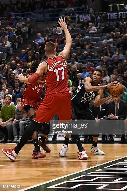 Giannis Antetokounmpo of the Milwaukee Bucks is defended by Jonas Valanciunas of the Toronto Raptors during a game at the BMO Harris Bradley Center...