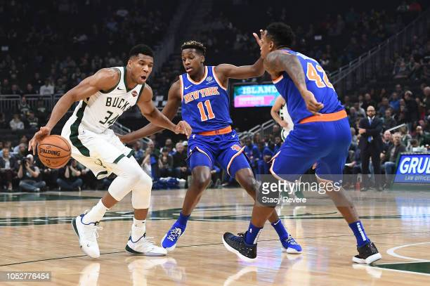 Giannis Antetokounmpo of the Milwaukee Bucks is defended by Lance Thomas and Frank Ntilikina of the New York Knicks during the first half of a game...