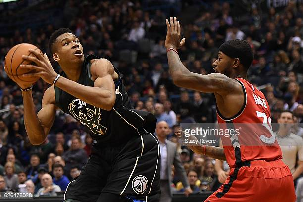 Giannis Antetokounmpo of the Milwaukee Bucks is defended by Terrence Ross of the Toronto Raptors during a game at the BMO Harris Bradley Center on...