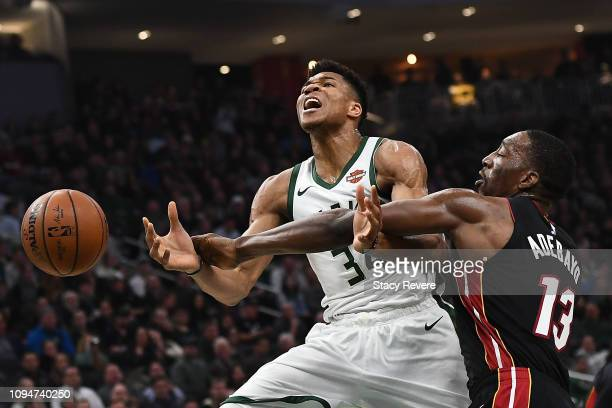 Giannis Antetokounmpo of the Milwaukee Bucks is fouled by Bam Adebayo of the Miami Heat during the first half of a game at Fiserv Forum on January 15...