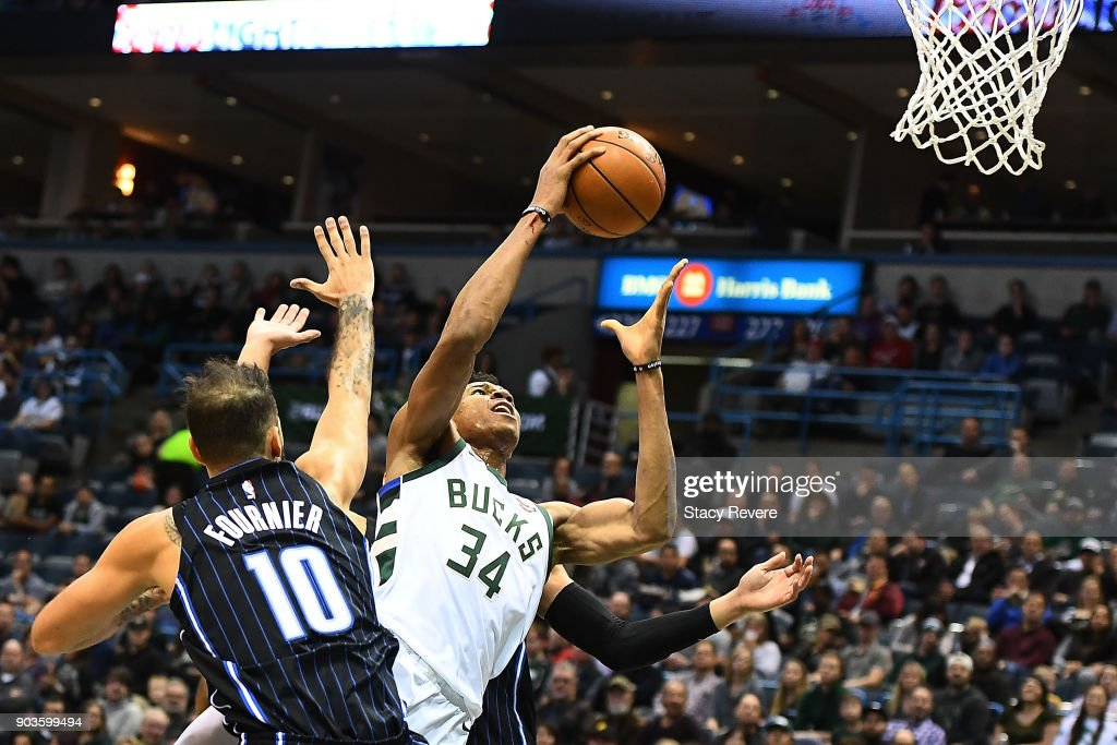 Giannis Antetokounmpo #34 of the Milwaukee Bucks is fouled by Evan Fournier #10 of the Orlando Magic during the first half of a game at the Bradley Center on January 10, 2018 in Milwaukee, Wisconsin.