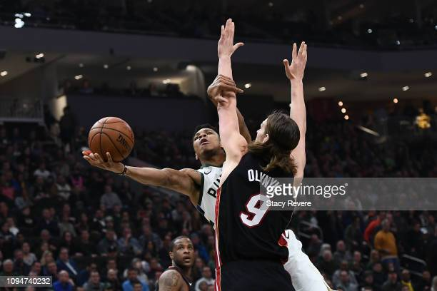 Giannis Antetokounmpo of the Milwaukee Bucks is fouled by Kelly Olynyk of the Miami Heat during the first half of a game at Fiserv Forum on January...