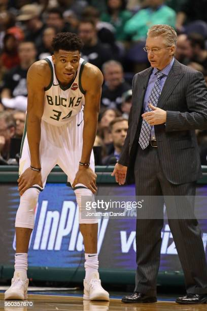 Giannis Antetokounmpo of the Milwaukee Bucks listens to instructions from head coach Joe Prunty during a game against the Boston Celtics during Game...