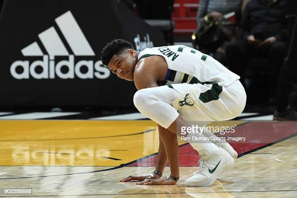 Giannis Antetokounmpo of the Milwaukee Bucks look on against the Miami Heat on January 14 2018 at American Airlines Arena in Miami Florida NOTE TO...