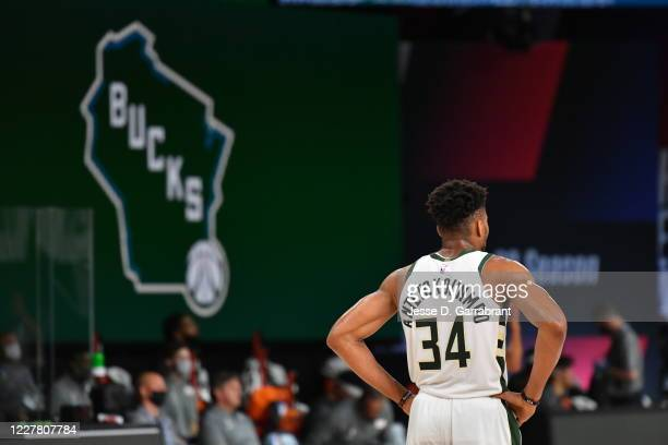 Giannis Antetokounmpo of the Milwaukee Bucks looks on during the game against the New Orleans Pelicans during a scrimmage on July 27, 2020 at The...