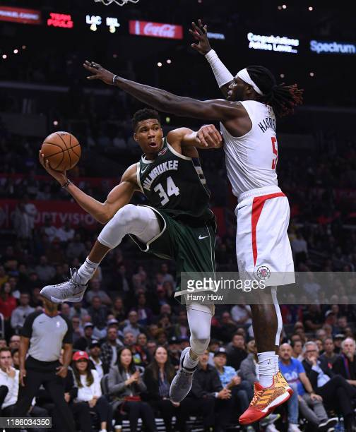 Giannis Antetokounmpo of the Milwaukee Bucks looks to make a pass around Montrezl Harrell of the LA Clippers during a 129124 Bucks win at Staples...