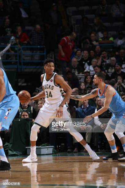 Giannis Antetokounmpo of the Milwaukee Bucks looks to pass against Austin Rivers of the Los Angeles Clippers during the NBA game on March 21 2018 at...