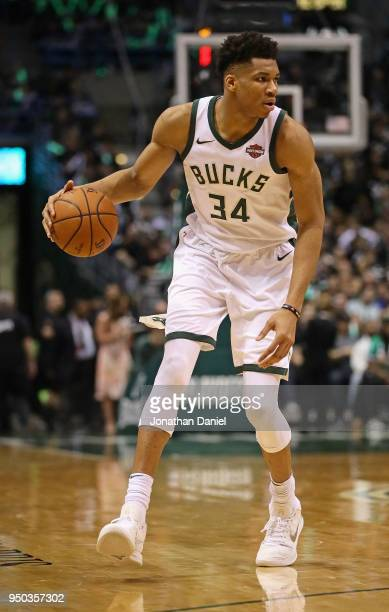 Giannis Antetokounmpo of the Milwaukee Bucks looks to pass against the Boston Celtics during Game Four of Round One of the 2018 NBA Playoffs at the...