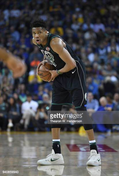 Giannis Antetokounmpo of the Milwaukee Bucks looks to pass the ball against the Golden State Warriors during an NBA basketball game at ORACLE Arena...